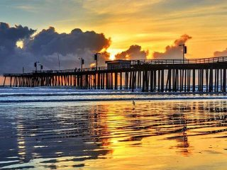 Sunset at the pier at Pismo Beach