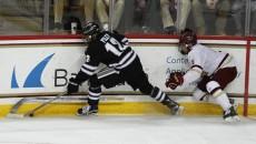 Steve Santini falls into the boards