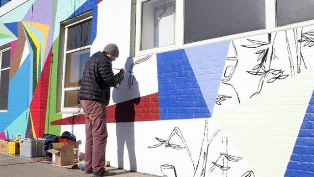 """Evo"" Mural Creates Vibrant Visual Masterpiece on Western Ave."