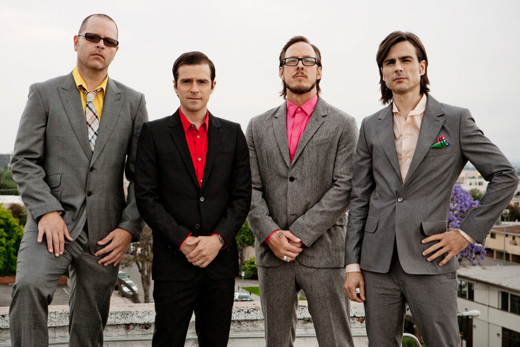 """Weezer Creates Bright and Eccentric World with """"Happy Hour"""""""