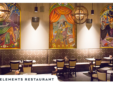 Eclectic Murals painted into arched alcoves hover behind tables spread throughout the Elements Restaurant dining room.