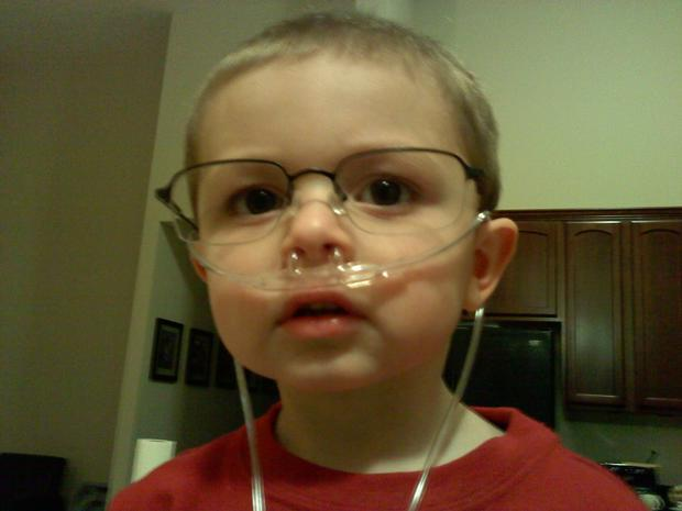Grandson 2, with papa bill's tube and glasses