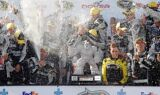 Jimmie Johnson takes the checkered flag at Dover