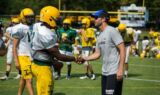 Johnson helps high school football team Beat the Heat