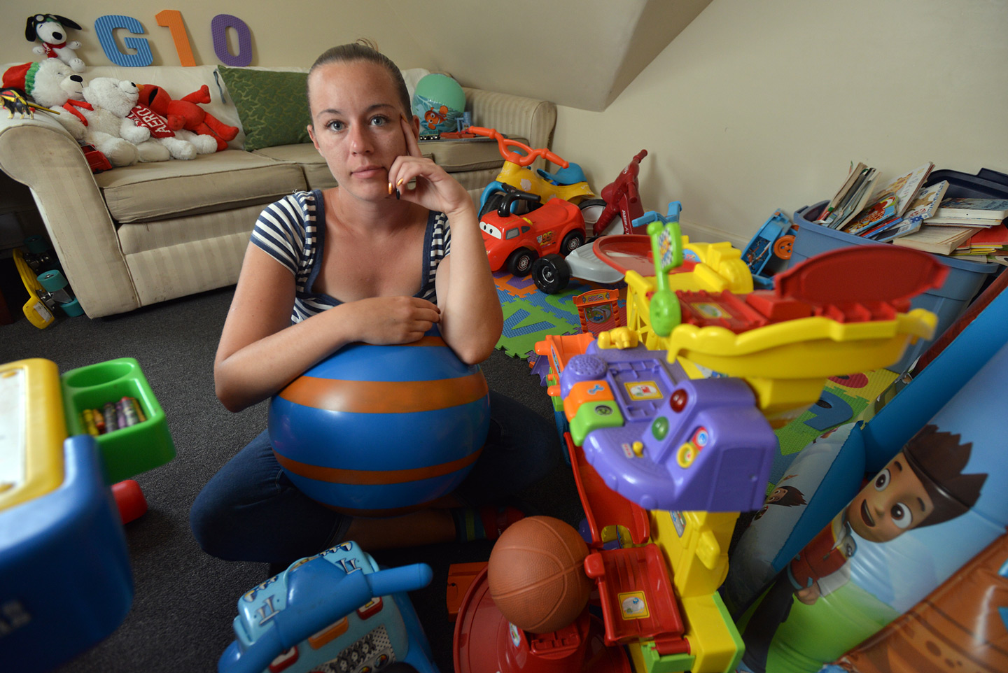Sitting with her son Giovanni's mostly unused toys, Kayla Duggan is reminded yet again of what her heroin addiction has cost her. Her son is in foster care and, like thousands of other addicted moms, Duggan's attempts to regain custody are thwarted both by her addiction and a lack of the one kind of treatment that could help her recover. ALLAN JUNG/ MetroWest Daily News