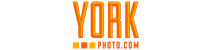 York photo logo. The logo is in all caps. The word YORK takes up the entire width of the logo. Below it are 3 small squares (below the YO) and PHOTO.COM. The logo has a bevel effect and is a combination of orange and yellow.