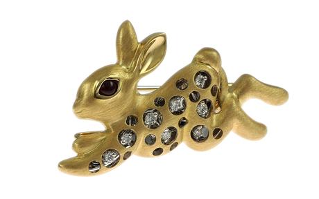 Brosche 750/- Gelbgold und Weißgold mit Diamanten und Rubin