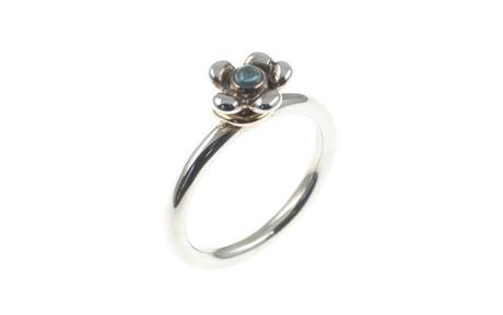 PANDORA Ring Blüte 925/- Sterlingsilber mit 14 kt Goldkranz und Blautopas