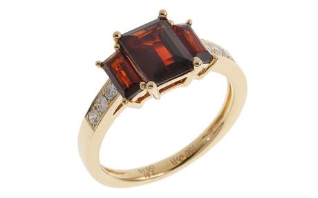 Ring 750/- Gelbgold mit Diamanten und Granaten