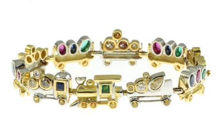 Armband 750/- Gelbgold und Weißgold mit fancy Diamonds, Rubinen, Smaragden und Saphiren