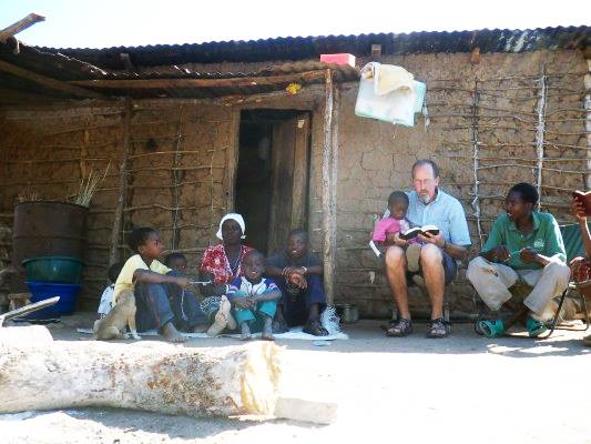 People in front of home