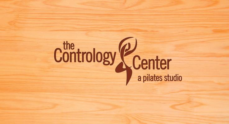 Contrology logo burned into wood