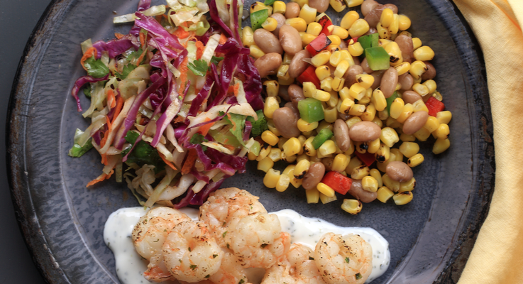 Hi rez cilantro lime shrimp with mexican crema  pinto beans  fire roasted corn and peppers  mexican cabbage slaw