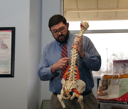 Dr. Adam teaching about the spine