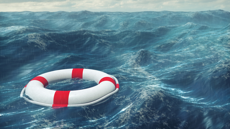 Stormy sea and lifesaving ring