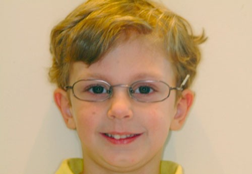 Child wearing well-fitting glasses