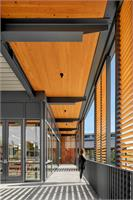 Sliding wood screens help manage glare and heat gain while creating varied intimate indoor outdoor spaces at the Janet Guild and Commons
