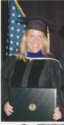 Picture of Julie holding a diploma