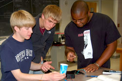 Students doing an experiment with a cup