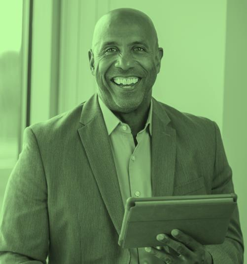 Man, smiling, with tablet computer