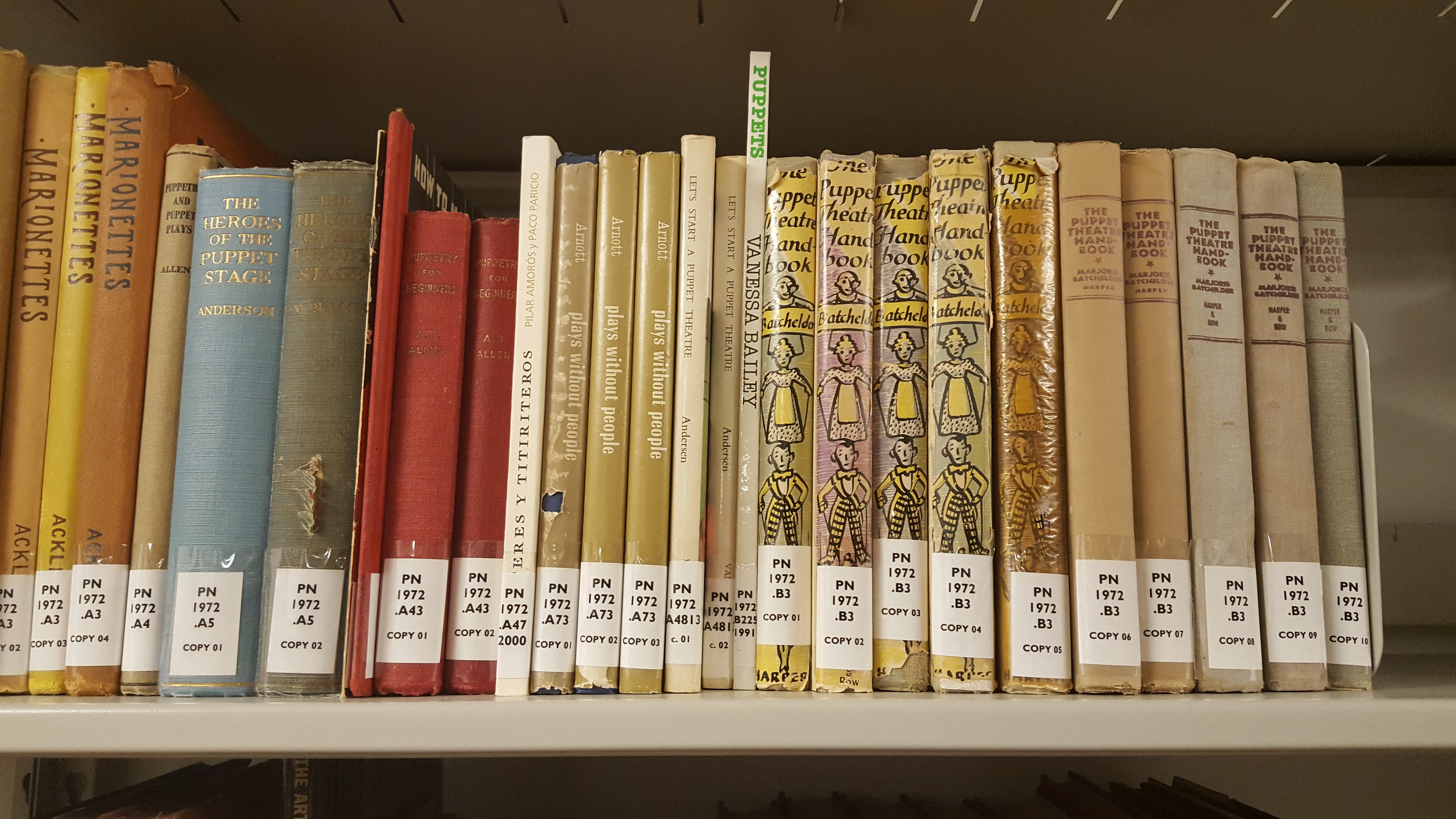 Books on a shelf in the Nancy Staub Puppetry Research Library