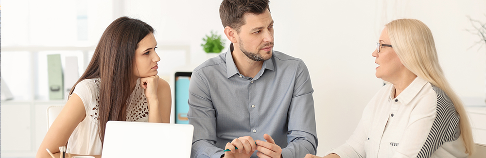 Young couple discussing Retirement plan with consultant in office