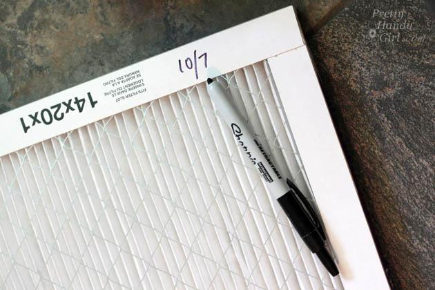 date written on air filter with Sharpie
