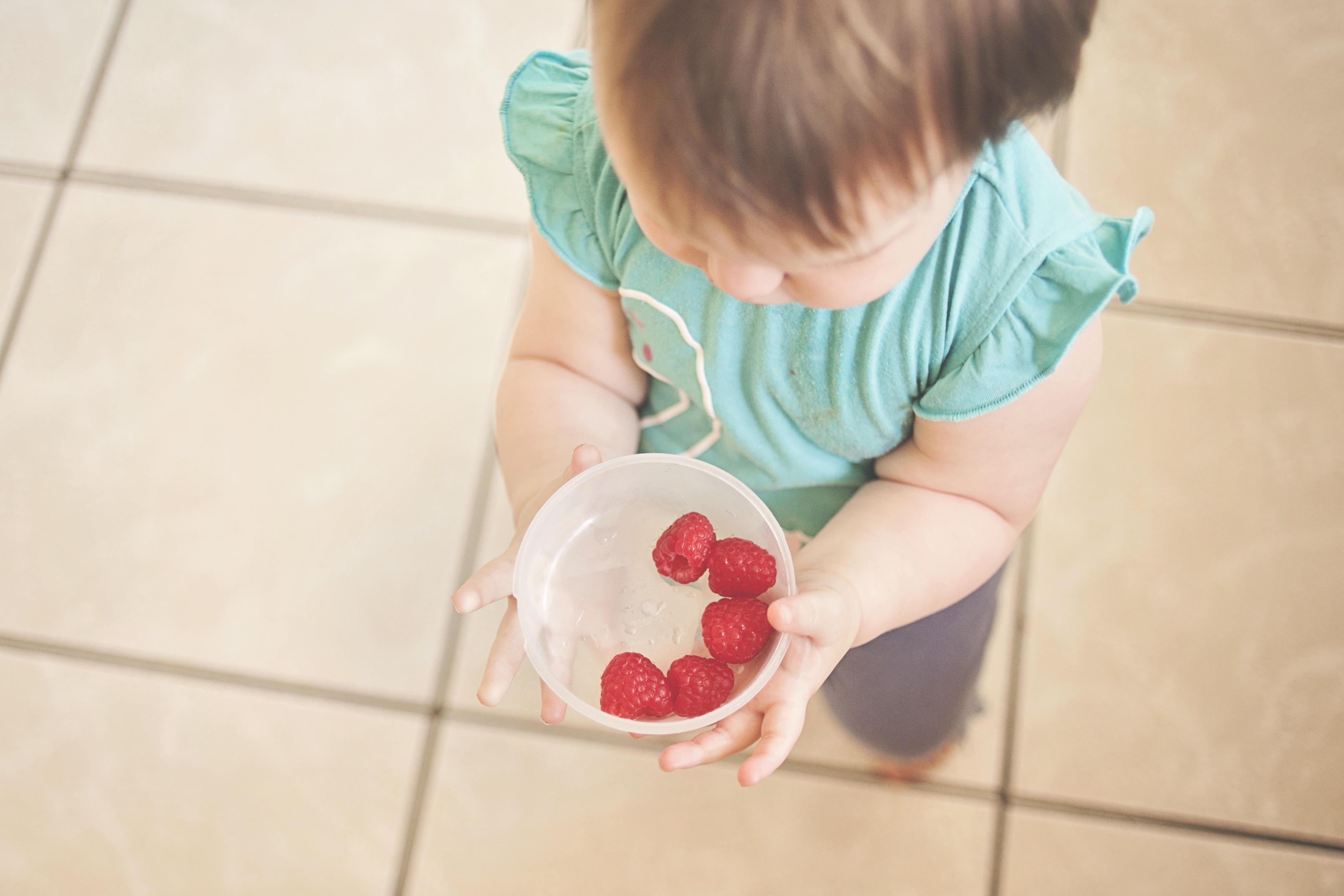 kid and raspberry bowl