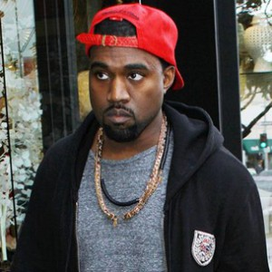 Kanye West Lashes Out At Paparazzi After Walking Into Street Sign