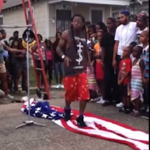 Lil Wayne Claims He Did Not Purposely Step On The American Flag In Video