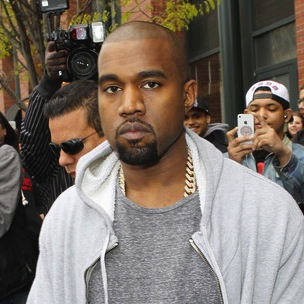 Kanye West Confronts Paparazzi In His Driveway
