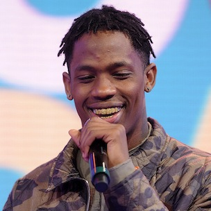 Travi$ Scott Details Kanye West Mentorship, Fighting With His Father