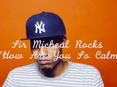 "Watch Sir Michael Rocks Do A Photo Shoot In ""How Are You So Calm"""