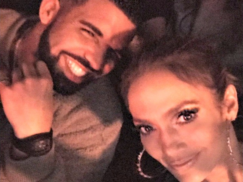 Drake Acts As Security Guard For Jennifer Lopez's Iced-Out Yankees Fitted