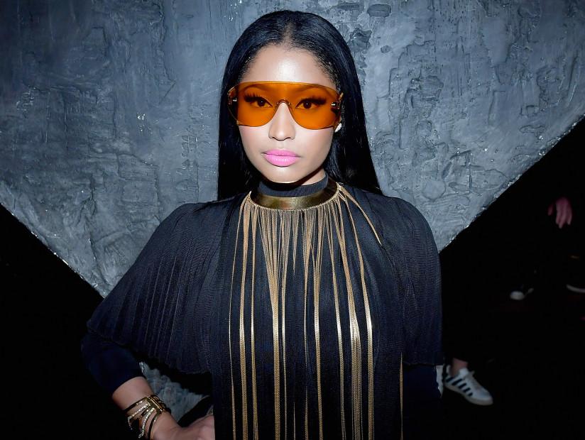 Nicki Minaj (& Her Exposed Breast) Sit Front Row At Paris Fashion Week (NSFW)