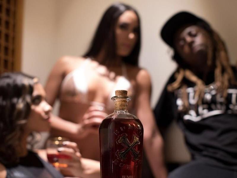 "Lil Wayne Flaunts ""Dedication 6"" Gear With Help From Trippie Redd"