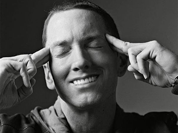 Someone Photoshops Smiles On Eminem's Photos & Hilarity Ensues