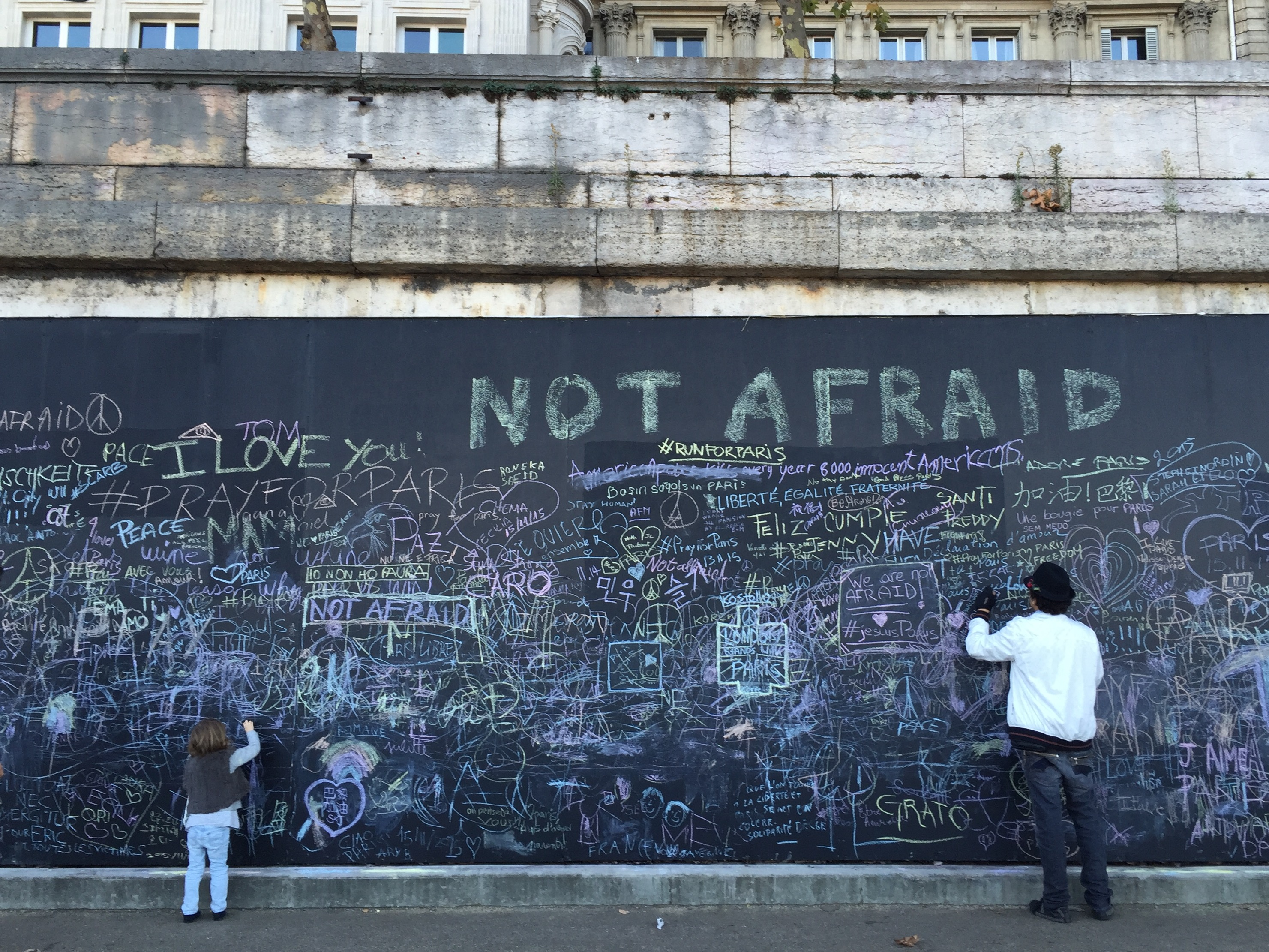 Paris after the attacks. Not Afraid. Seine river art and commemoration