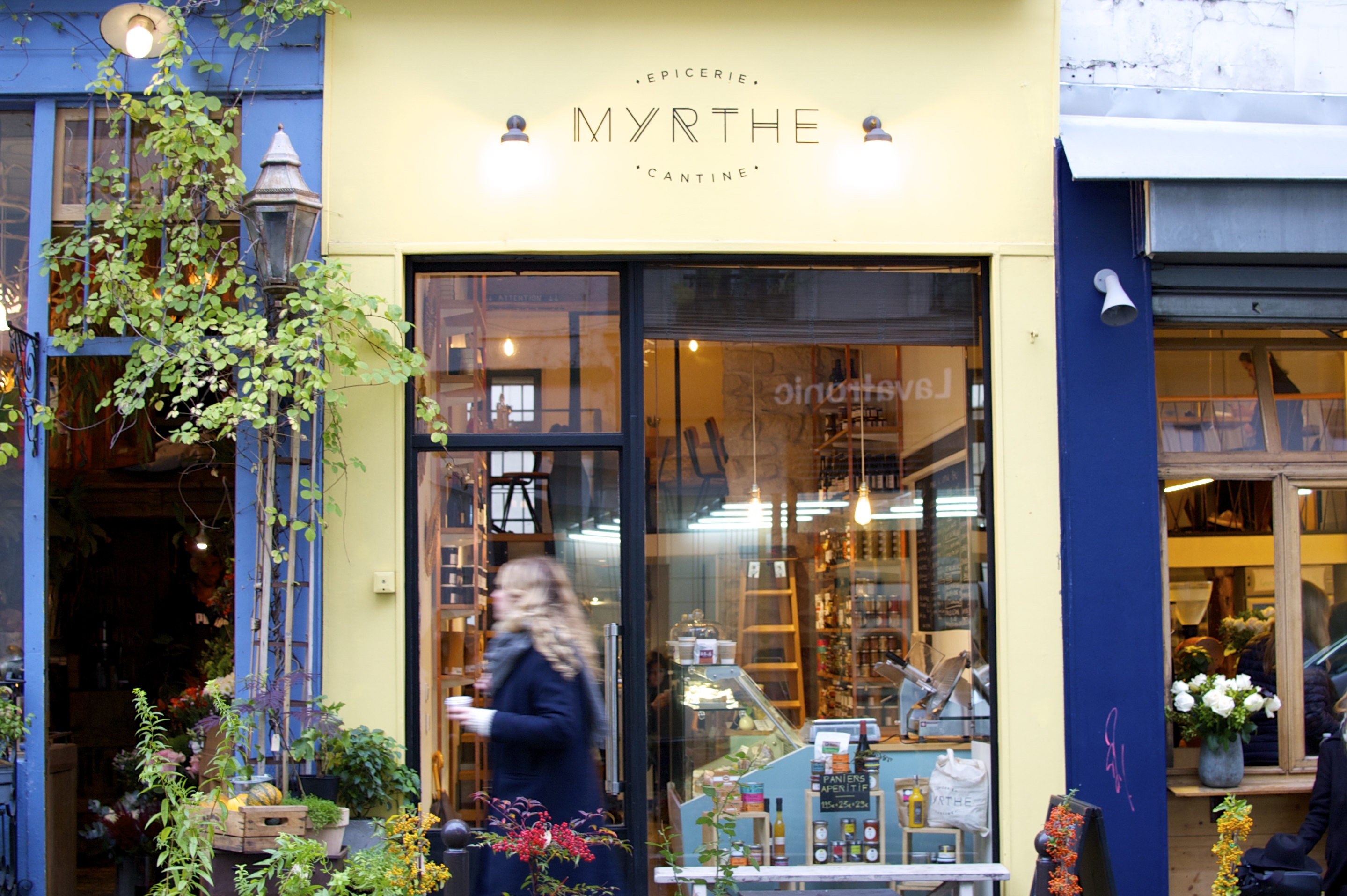 HiP Paris blog. Myrthe, a locally sourced epicerie and cantine off of the Canal Saint Martin. Street view of the colorful cantine.