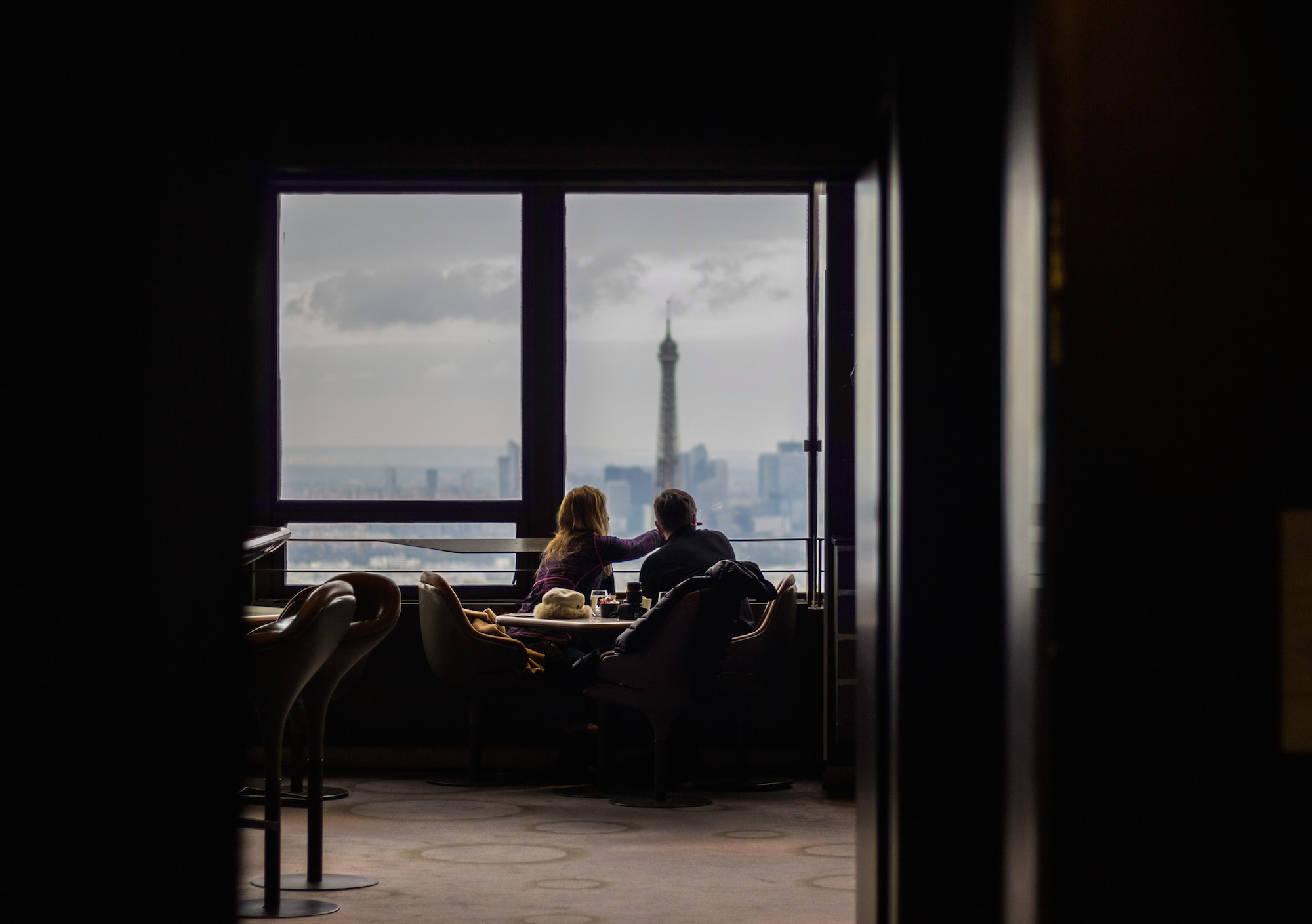 Learning French is easier when you have a French friends you can practise with, like this woman and man having coffee at a café overlooking the Eiffel Tower.