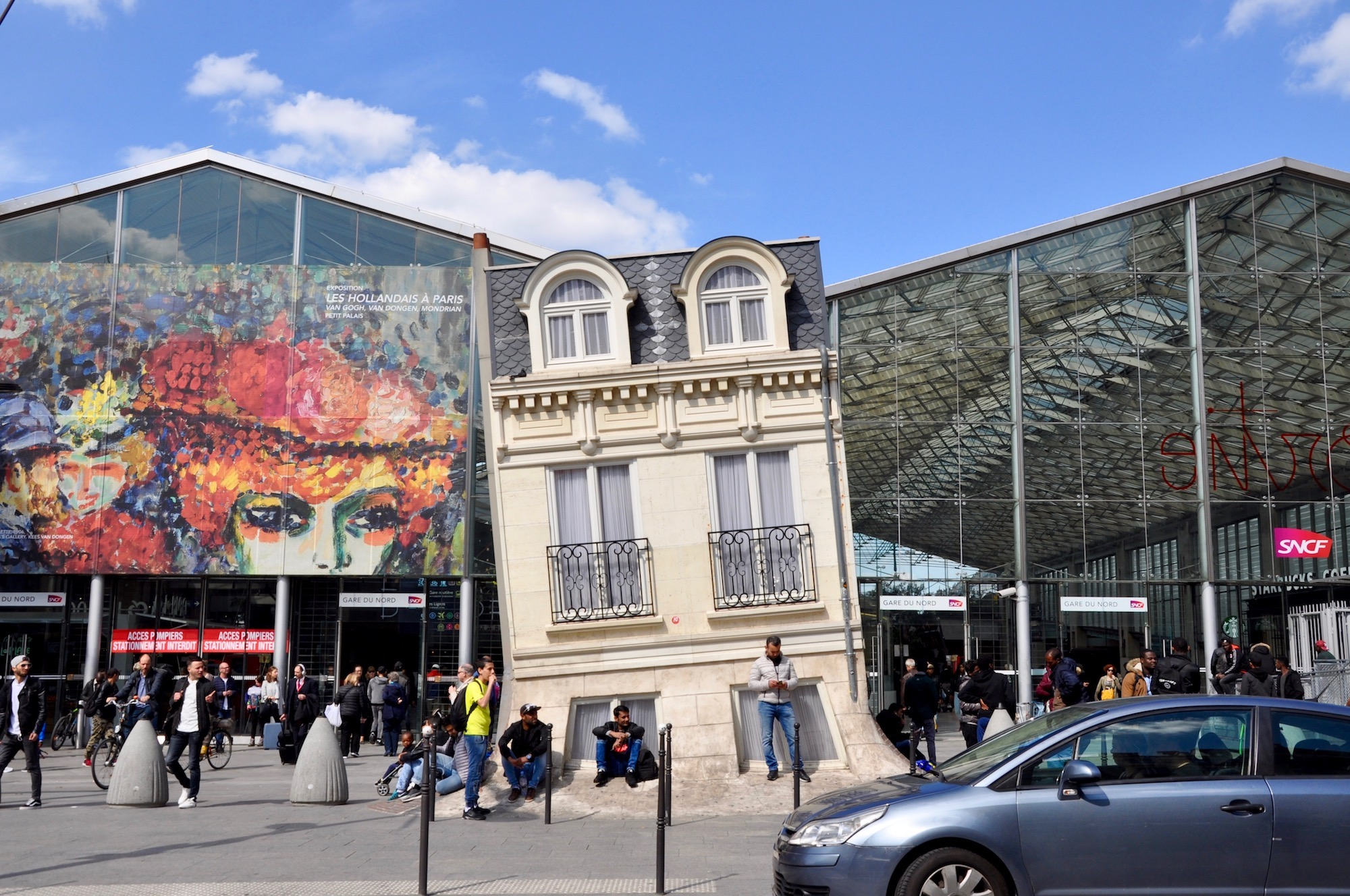 Where to eat around Gare du Nord station in Paris, and see art like this Leadro Erlich installation.