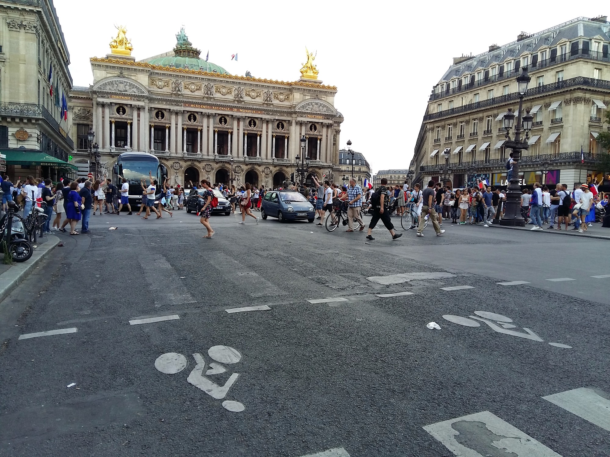 People celebrating in Paris when France won the World Cup in 2018 in front of the opera house.