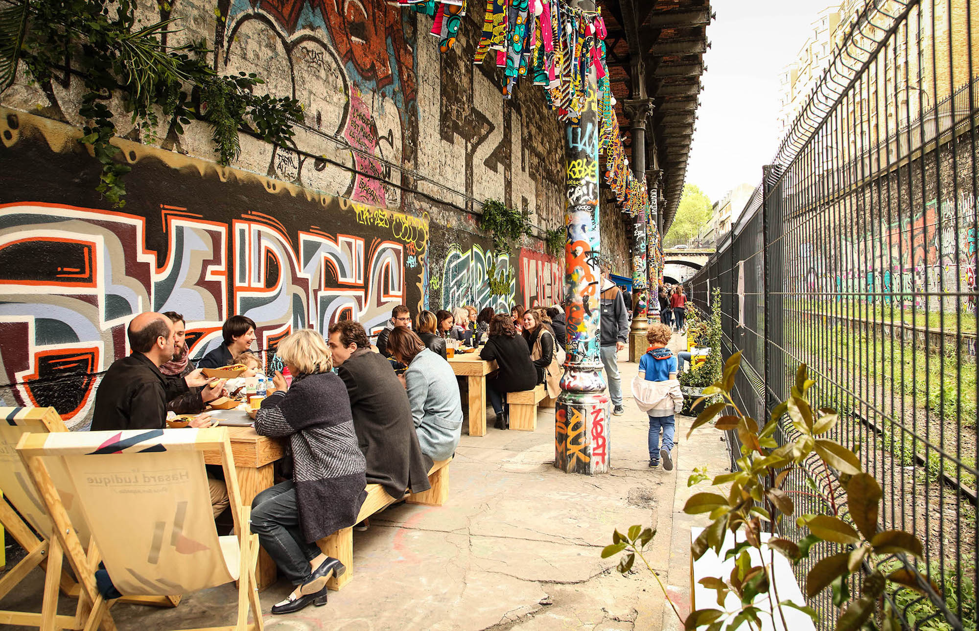 HiP Paris Blog rounds up new summer hangouts in Paris including the Hasard Ludique bar with its outdoor terrace covered in graffiti set along the platform of an abandoned train station.