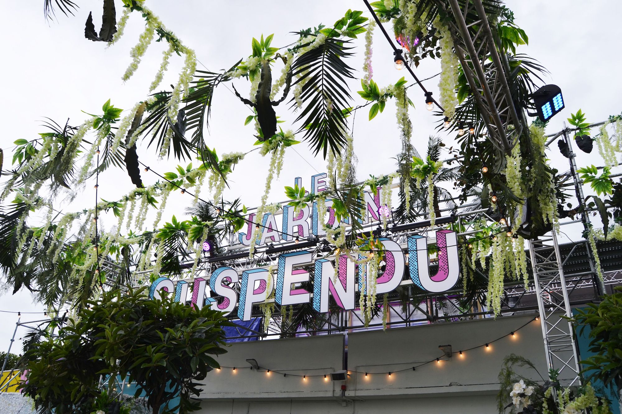 Paris rooftop bar Le Jardin Suspendu (the hanging garden) name adorned with leafy decor.