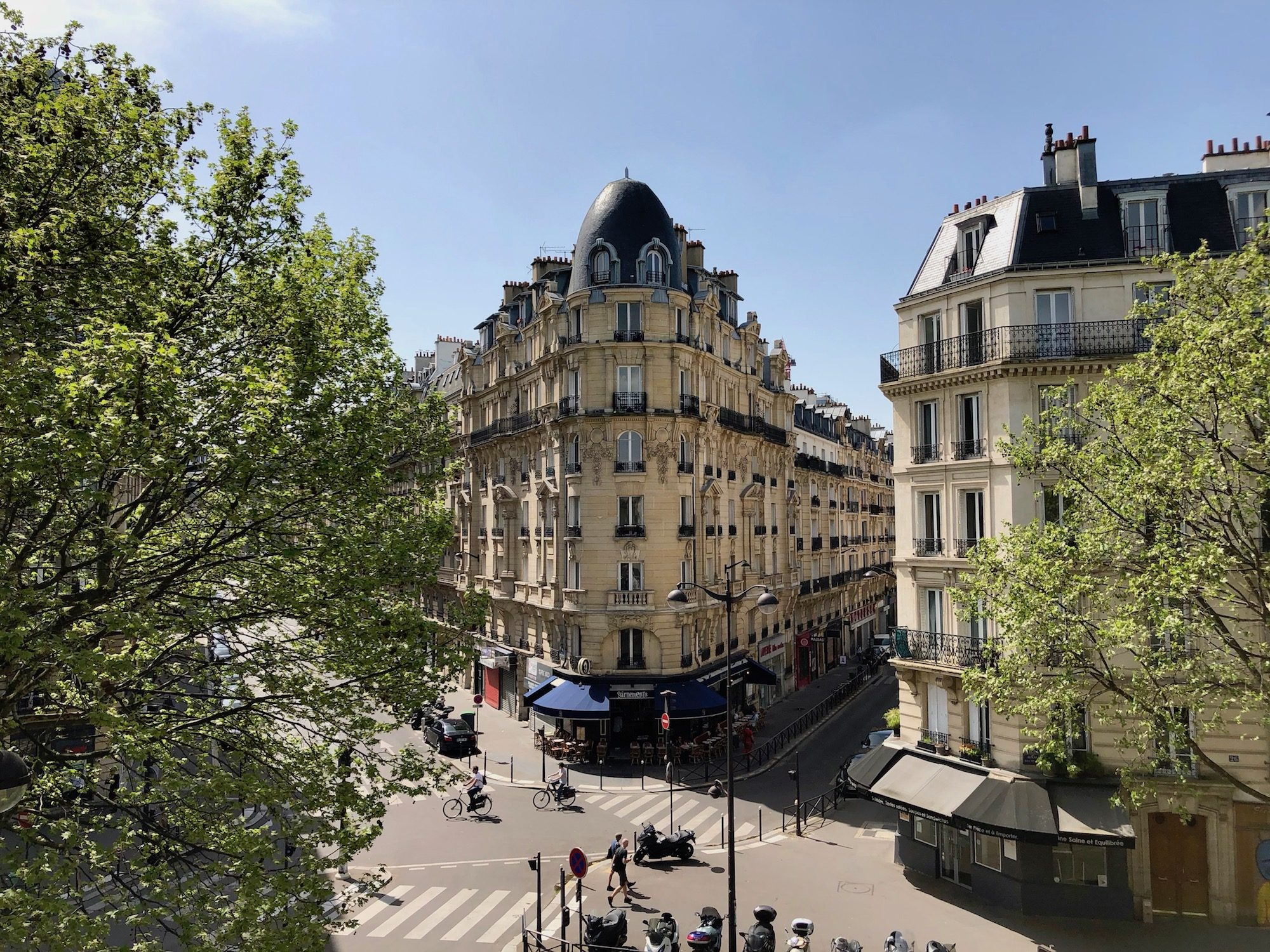Paris is most beautiful in the summer with its Haussmann architecture gleaming in the sunshine.