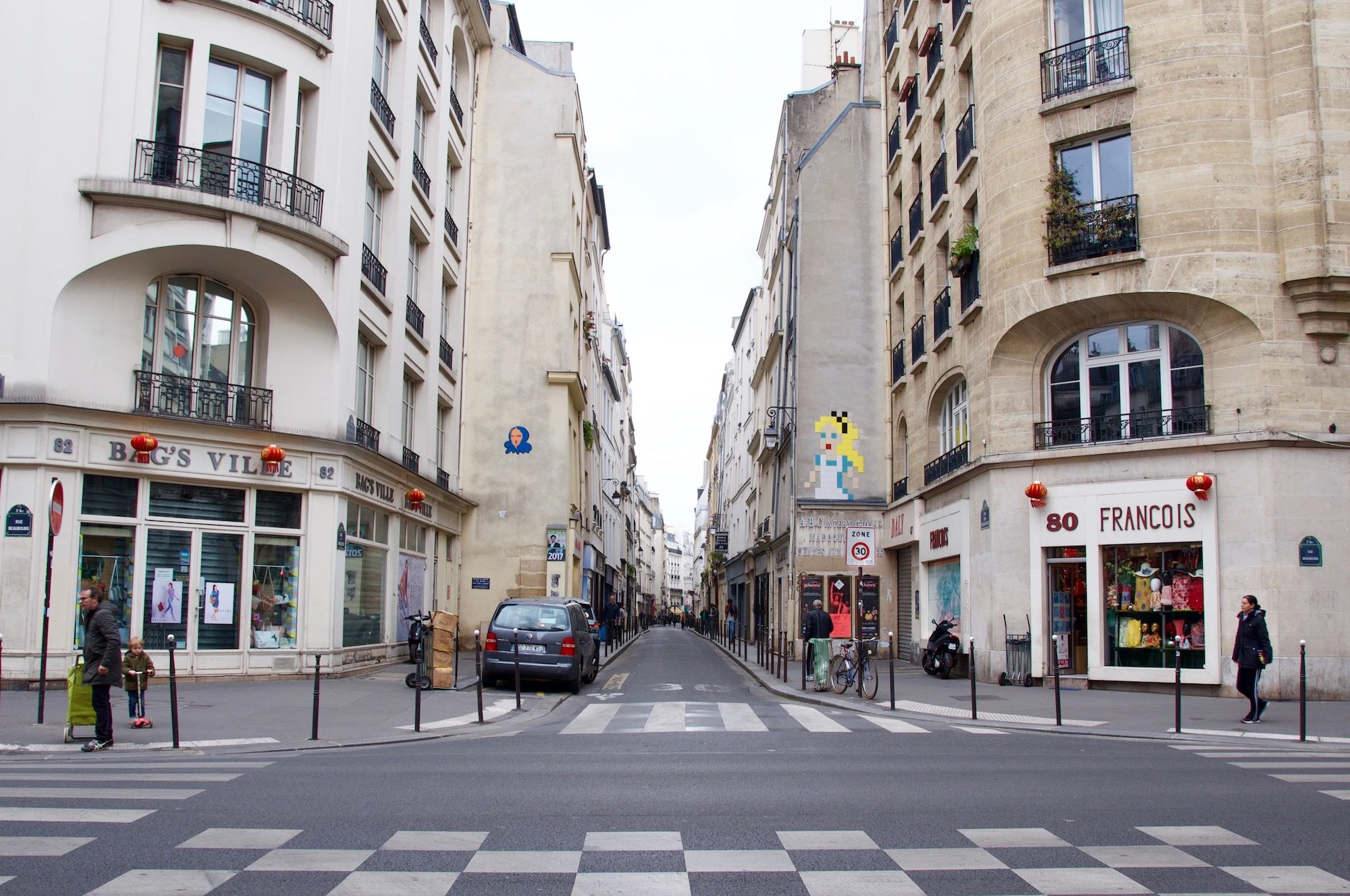 Street art in Paris has become huge and locals love to spot Invader's street art mosaics all over Paris.