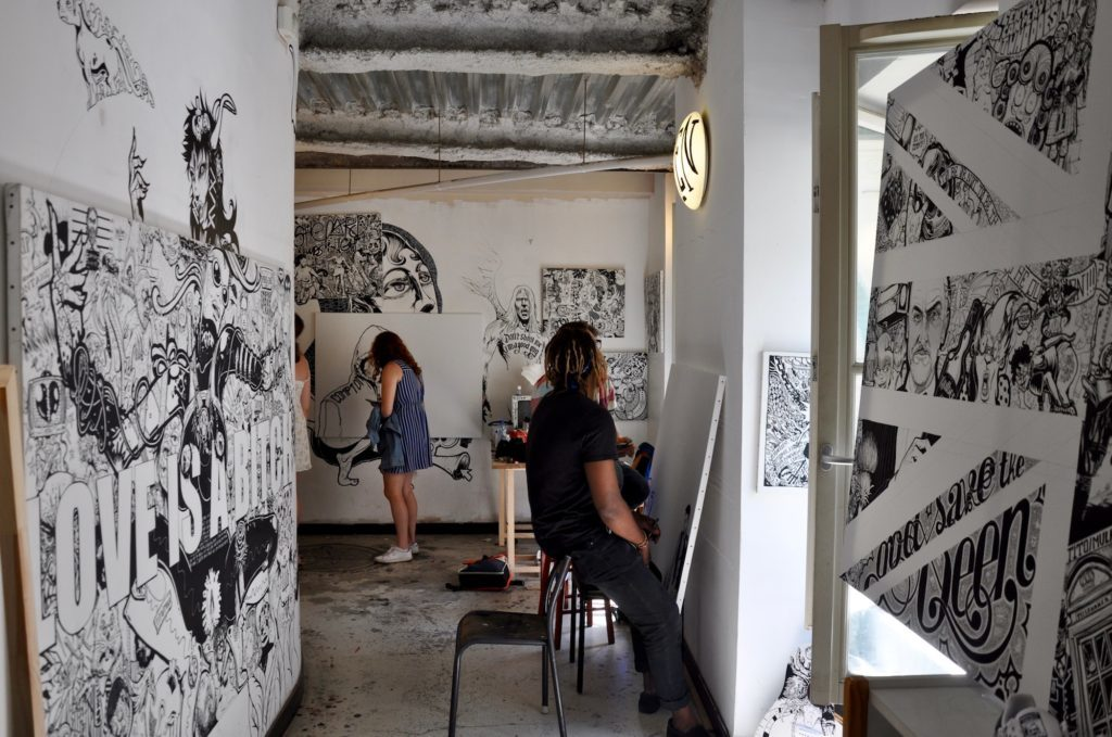 HiP Paris Blog discovers the many artist squats in Paris like the Shakirail where artists work on their projects like these two people.