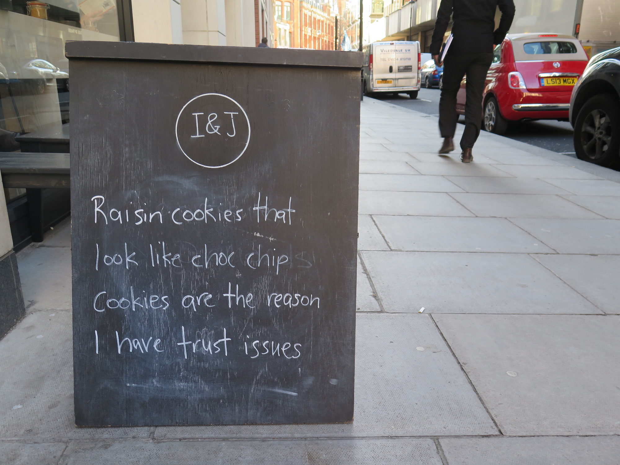 Paris or London for humor? We'd say London for its funny coffee shop street signs.