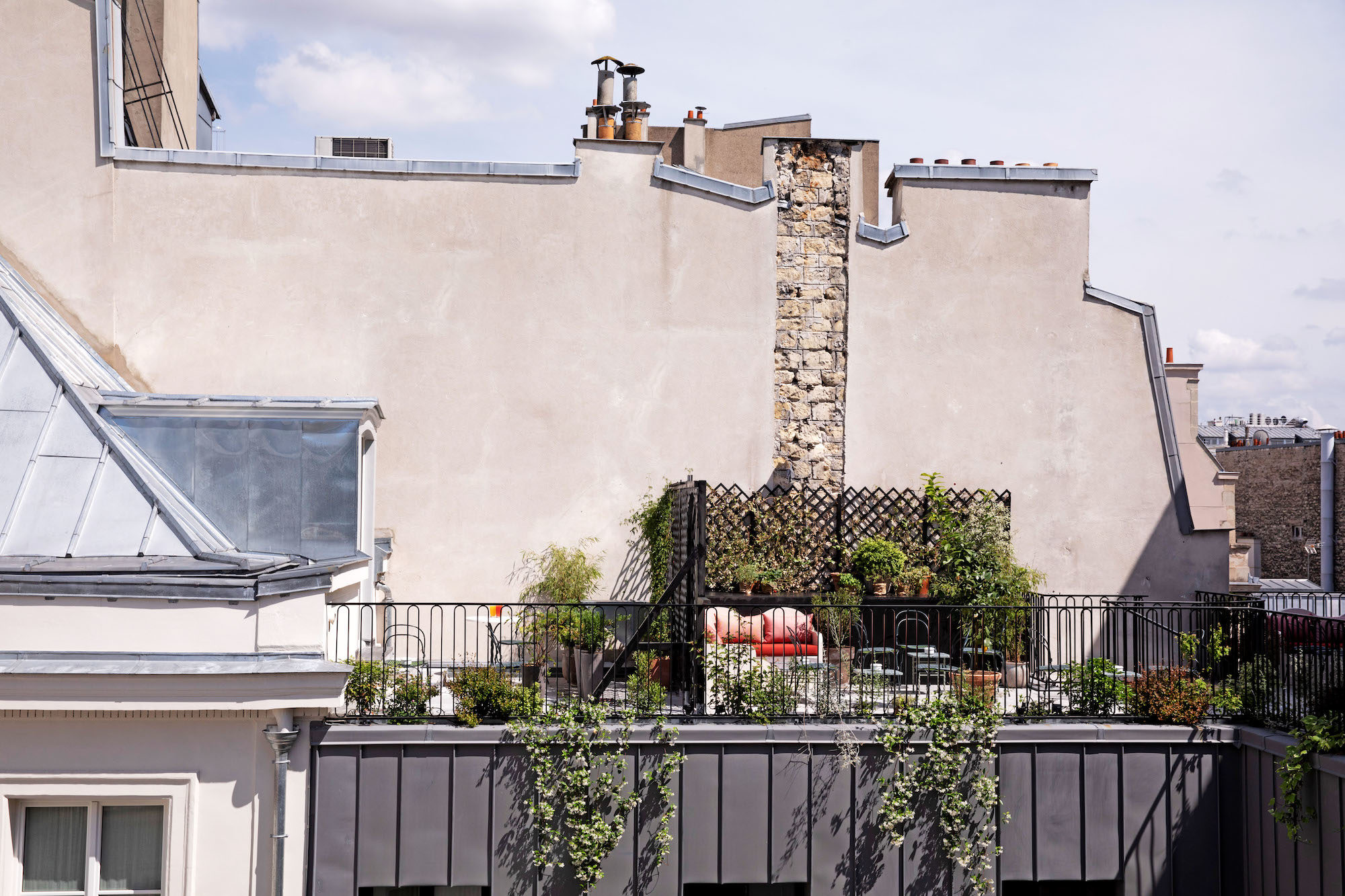 Paris rooftop bar The Shed, is laid-back and has a pretty terrace adorned with plants.