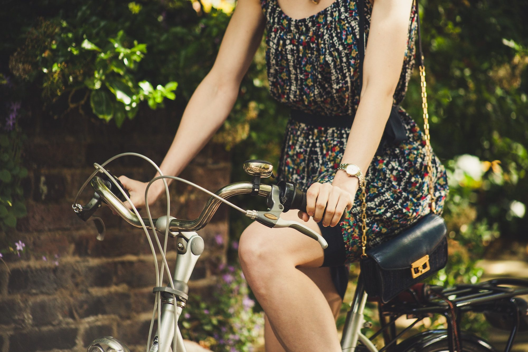 In summer, Londoners get around mostly on their bikes, like this girl wearing a summer dress.